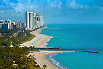 The beach of Bal Harbour Village sits at the northern tip of Miami Beach.  The Haulover inlet separates Miami Beach from Haulover Beach Park and the high rise residential condominiums of the city of Sunny Isles Beach.