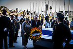 Israeli President Reoven Rivlin and his wife Nechama lay a wreath as they pay their respects to Former president Shimon Peres's casket placed outside the Knesset Israelis parliament in Jerusalem so that the public may pay its last respects on Thursday Sept 29 2016. Peres 93 passed away Tuesday, he was the last member of Israel's founding generation, and was feted internationally as a visionary man of peace. Photo by Eyal Warshavsky