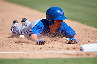 Toronto Blue Jays first baseman Brett Wright (20) slides into third base during a Florida Instructional League game against the Philadelphia Phillies on September 24, 2018 at Spectrum Field in Clearwater, Florida.  (Mike Janes/Four Seam Images)