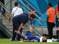 Jose Cholevas of Greece is given treatment at full time before extra time