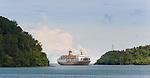 A PELNI ship manuevers the deep but narrow inlet to Banda harbor.