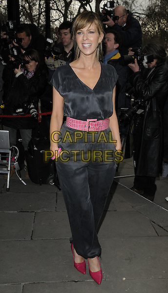 KATE GARRAWAY.The TRIC Awards 2010 (Television and Radio Industries Club) held at the Grosvenor hotel - outside arrivals London, England. .March 9th 2010.full length black silk satin trousers top jumpsuit pink belt hands in pockets shoes .CAP/CAN.©Can Nguyen/Capital Pictures.
