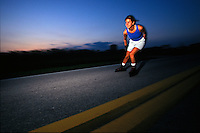Female rollerblading on the street during sunset