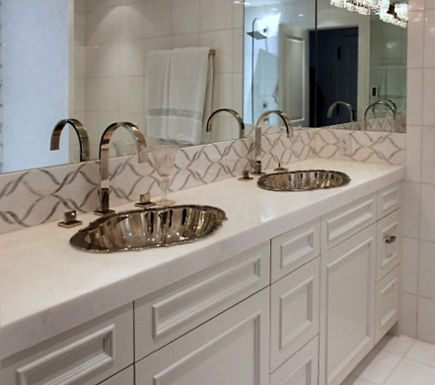 This custom bathroom backsplash features Sophie, a handmade mosaic shown in polished Calacatta Tia and honed Thassos, a part of the Silk Road Collection by Sara Baldwin for New Ravenna.<br /> -photo courtesy of Beth Fults / Decorative Materials<br /> <br /> For pricing samples and design help, click here: http://www.newravenna.com/showrooms/
