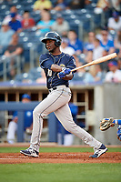 San Antonio Missions starting pitcher Enyel De Los Santos (10) follows through on a swing during a game against the Tulsa Drillers on June 1, 2017 at ONEOK Field in Tulsa, Oklahoma.  Tulsa defeated San Antonio 5-4 in eleven innings.  (Mike Janes/Four Seam Images)