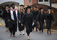 NWA Media/ANDY SHUPE - Graduates participate in the University of Arkansas fall commencement exercises Saturday, Dec. 20, 2014, at Barnhill Arena on the university campus in Fayetteville.