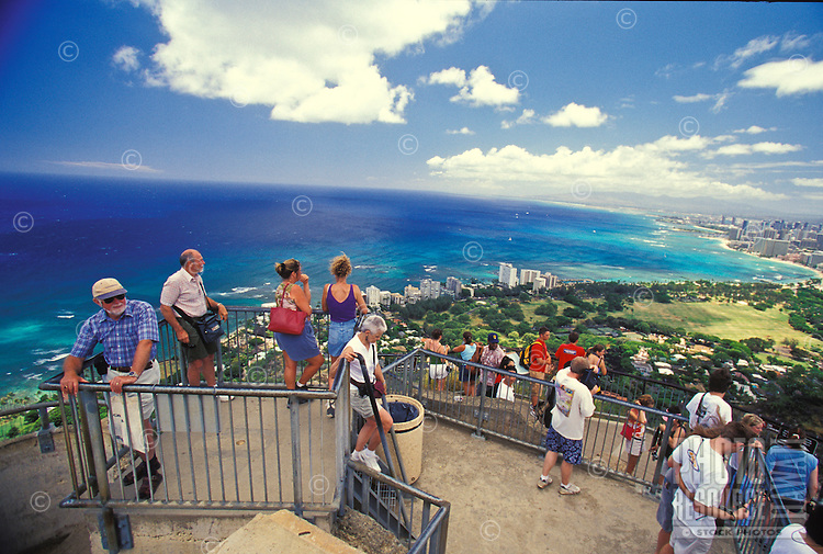Families and groups hiking the Diamond Head Trail to lookout over Waikiki  at summit