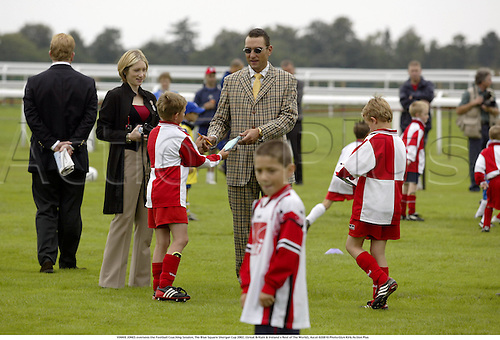 VINNIE JONES oversees the Football Coaching Session, The Blue Square Shergar Cup 2002, (Great Britain & Ireland v Rest of The World), Ascot 020810 Photo:Glyn Kirk/Action Plus...Horse racing.boy boys lesson training  girl girls.children kids child soccer coach teacher teaching