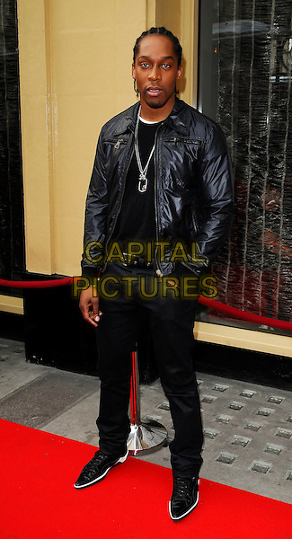 LEMAR aka Lemar Obika.Tesco Mum of the Year Awards at the Waldorf Hilton Hotel, London, England, March 1st 2009.full length black jacket leather shiny necklace trousers hand in pocket pointy shoes .CAP/CAN.©Can Nguyen/Capital Pictures