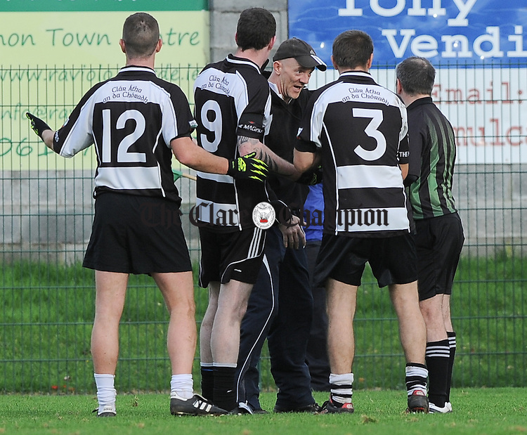 Clarecastle manager Derek Dormer and players have a word with referee Robert Harte during their Junior B county football final against Cratloe in Shannon. Photograph by John Kelly.
