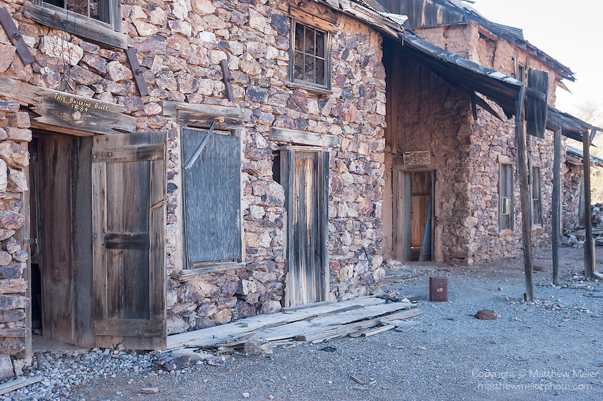 The Vulture Gold Mine, Vulture City, Arizona; exterior view of the abandoned Assay Office, built in 1884 out of ore from the mine, it's walls contain over $600 thousand in gold and silver