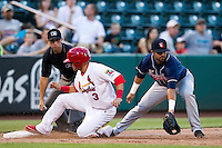 Jose Garcia (3) of the Springfield Cardinals slides safely into third base during a game against the Arkansas Travelers at Hammons Field on July 25, 2012 in Springfield, Missouri. (David Welker/Four Seam Images)