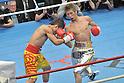 (L-R) Suriyan Sor Rungvisai (THA), Yota Sato (JPN),.MARCH 26, 2012 - Boxing :.Yota Sato of Japan in action against Suriyan Sor Rungvisai of Thailand in the third round during the WBC super flyweight title bout at Korakuen Hall in Tokyo, Japan. (Photo by Hiroaki Yamaguchi/AFLO)..