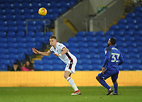 Bolton Wanderers' Reece Burke heads clear despite the attentions of Cardiff City's Junior Hoilett<br /> <br /> Photographer Kevin Barnes/CameraSport<br /> <br /> The EFL Sky Bet Championship - Cardiff City v Bolton Wanderers - Tuesday 13th February 2018 - Cardiff City Stadium - Cardiff<br /> <br /> World Copyright &copy; 2018 CameraSport. All rights reserved. 43 Linden Ave. Countesthorpe. Leicester. England. LE8 5PG - Tel: +44 (0) 116 277 4147 - admin@camerasport.com - www.camerasport.com