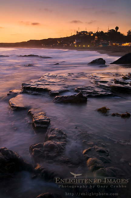 Waves on coastal rocks at sunset, Crystal Cove State Park Historic District beach, Corona del Mar, Newport Beach, California