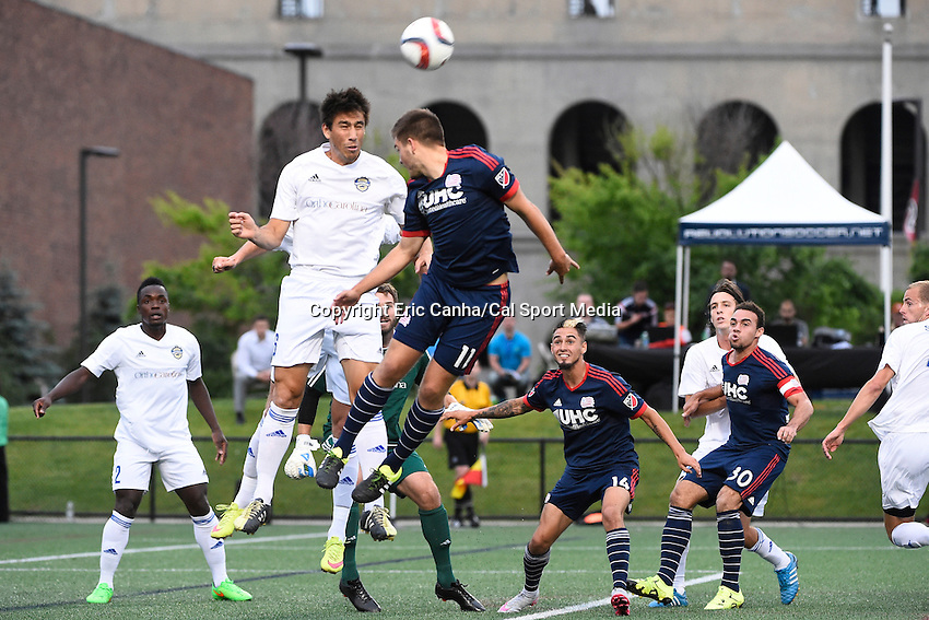 June 17, 2015 - Boston, Massachusetts, U.S. - New England Revolution midfielder Kelyn Rowe (11) and Charlotte Independence defender Andrew Ribeiro (6) both leap for the ball during the US Open Cup fourth round between the New England Revolution and the Charlotte Independence held at Harvard's Soldiers Field Soccer Stadium. The Independence defeated the Revolution 1-0.  Eric Canha/CSM