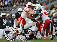 23 November 2013:  Nebraska CB Ciante Evans (17) hits Penn State RB Zach Zwinak (28) knocking him backwards to the ground.The Nebraska Cornhuskers defeated the Penn State Nittany Lions 23-20 in overtime at Beaver Stadium in State College, PA.
