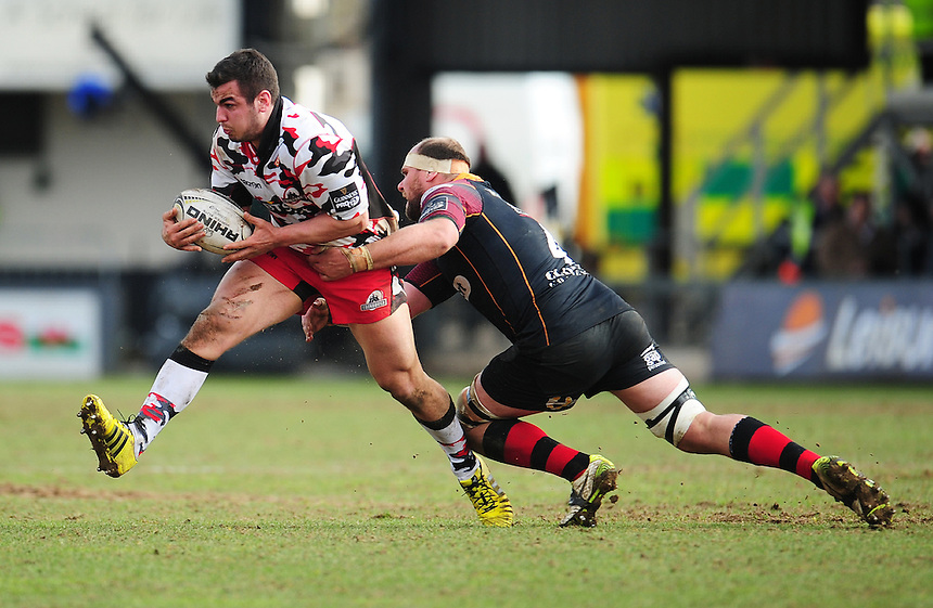 Edinburgh's Stuart McInally is tackled by Dragons' Cory Hill<br /> <br /> Photographer Kevin Barnes/CameraSport<br /> <br /> Rugby Union - Guinness PRO12 Round 18 - Newport Gwent Dragons v Edinburgh Rugby - Sunday 27th March 2016 - Rodney Parade - Newport<br /> <br /> &copy; CameraSport - 43 Linden Ave. Countesthorpe. Leicester. England. LE8 5PG - Tel: +44 (0) 116 277 4147 - admin@camerasport.com - www.camerasport.com