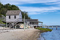 Rustic boathouse on the beach.