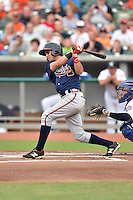 Mississippi Braves second baseman Jose Peraza #7 swings at a pitch during a game against the Tennessee Smokies at Smokies Park on July 21, 2014 in Kodak, Tennessee. The Braves defeated the Smokies 4-3. (Tony Farlow/Four Seam Images)