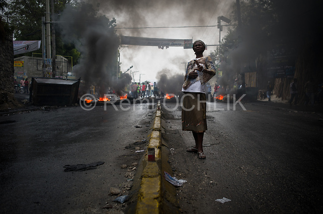 "© Remi OCHLIK/IP3 - Port au Prince on 2010 december 9 - PORT-AU-PRINCE -- Clashes and shooting were reported Thursday in Haiti's capital for a second day as demonstrators staged a march to protest what they said was election fraud in the Nov. 28 presidential elections..The protests broke out Wednesday after election officials announced Tuesday night that two candidates had made it into a runoff: Mirlande Manigat, a former first lady, and Jude CÈlestin, the candidate of current President RenÈ PrÈval's party. Out of the running was Michel ""Sweet Micky'' Martelly, who early results had shown running second. - Martelly supporters demonstrate in Petion Ville and set up roadblocks on Delmas street."