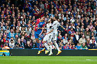 Sun 22 September 2013<br /> <br /> Pictured: Marouane Chamakh of Crystal Palace Jose Canas  of Swansea and Chico Flores of Swansea in a mid air challenge<br /> <br /> Re: Barclays Premier League Crystal Palace FC  v Swansea City FC  at Selhurst Park, London