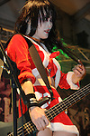 Chthonic Concert, Kaohsiung -- Doris Yeh of the Taiwanese Black Metal band Chthonic rocking in a Santa Claus costume.