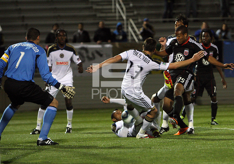 Ethan White(15) of D.C. United battles with Kyle Nakazawa(13) and Carlos Valdes(5) of the Philadelphia Union during a play-in game for the US Open Cup tournament at Maryland Sportsplex, in Boyds, Maryland on April 6 2011. D.C. United won 3-2 after overtime penalty kicks.
