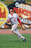 Greeneville Reds left fielder Nate Scantlin (17) tracks a fly ball during the first game of a doubleheader against the Princeton Rays on July 25, 2018 at Hunnicutt Field in Princeton, West Virginia.  Princeton defeated Greeneville 6-4.  (Mike Janes/Four Seam Images)