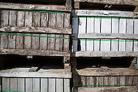 Apple boxes stand in stacks at Carver Hill Orchard in Stow, Massachusetts, USA.