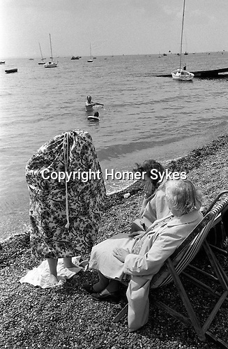 Getting changed into swim wear. Southend on Sea, Essex. England. 1974