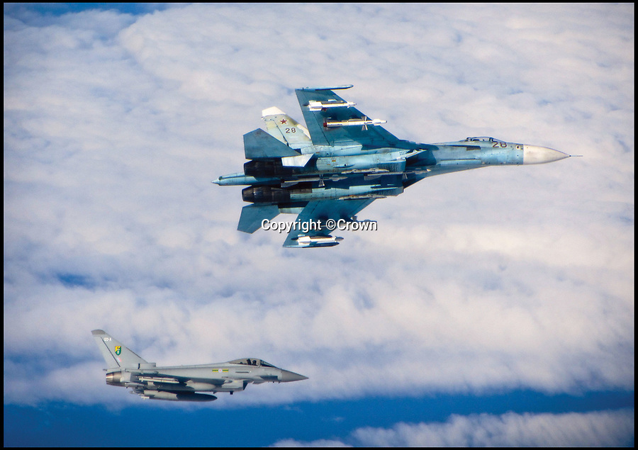 BNPS.co.uk (01202)558833Pic: Crown/BNPS<br /> <br /> A Russian Air Force sukhoi Su-27 Flanker with a Tphoon FGR4 of 3 Squadron over the Baltic Sea in June 2014.<br /> <br /> These breathtaking photos capture in all its glory the storied history of the mighty Royal Air Force which has defended our shores for 100 years.<br /> <br /> Former fighter pilot Michael Napier celebrates the accomplishments of the world's first independent air force in his new book The Royal Air Force, A Centenary of Operations.<br /> <br /> He reflects on the momentous Battle of Britain where 'the Few' stood up to the dreaded Luftwaffe and also lesser-known humanitarian operations in far-flung parts of the world where the RAF 'dropped food, not bombs'.