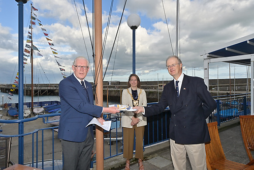 NYC Commodore Martin McCarthy presents 150th Flag to RSGYC Commodore Peter Bowring with DLR CoCo Caothaoirleach Una Power attending.
