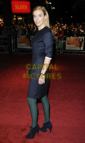 """THEKLA REUTEN .""""The American"""" premiere during the 54th BFI London Film Festival, Vue West End cinema, London, England, UK, .October 16th 2010..LFF full length blue navy dress green tights ankle boots black clutch bag suede side .CAP/CAN.©Can Nguyen/Capital Pictures."""