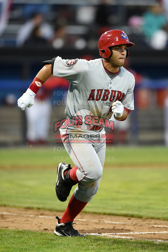 Auburn Doubledays first baseman Jose Marmolejos-Diaz (14) runs to first during a game against the Batavia Muckdogs on June 14, 2014 at Dwyer Stadium in Batavia, New York.  Batavia defeated Auburn 7-2.  (Mike Janes/Four Seam Images)