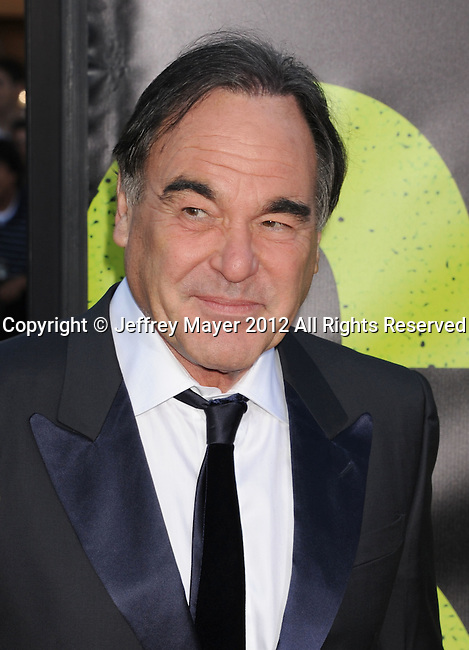 WESTWOOD, CA - JUNE 25: Oliver Stone and Sun-jung Jung arrive at the Los Angeles premiere of 'Savages' at Mann Village Theatre on June 25, 2012 in Westwood, California.