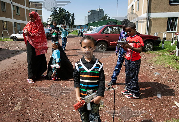 Children hold toy guns, a popular gift which they receive at the end of Ramadan, Eid Mubarak.
