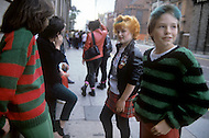 August 1981. Newcastle area, England. During this time the Punk movement begins, and tattoos, piercings, and colorful hair become popularized. At the same time the Romantic movement is born, and makeup, black and white clothing are the typical fashion seen at night clubs and dance parlors.