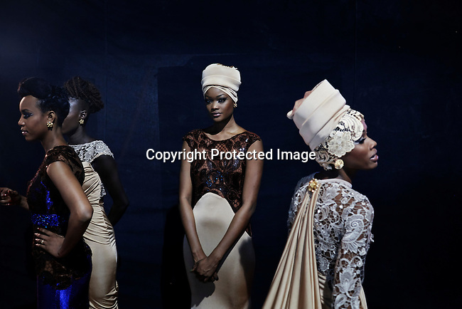 DAKAR, SENEGAL - JUNE 21: Models for the Nigerian designer label Ejiro Amos Tafiri wait backstage before a show at Dakar Fashion Week on June 21, 2014, at Hotel des Almadies in Dakar, Senegal. Seventeen Senegalese, African and foreign-based designers showed their collections during the 12th edition of Dakar Fashion week. (Photo by Per-Anders Pettersson)