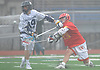 Will Kusnierek #33 of Chaminade, right, snaps off a shot while defended by Kevin Lynskey #19 of Massapequa during a non-league varsity boys lacrosse game at Massapequa High School on Wednesday, April 4, 2018. Chaminade won by a score of 8-5.