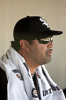 Ozzie Guillen #13, manager of the Chicago White Sox, observes a spring training game against the Arizona Diamondbacks at Salt River Fields on March 10, 2011 in Scottsdale, Arizona. .Photo by:  Bill Mitchell/Four Seam Images.