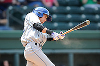 Shortstop Emerson Jimenez (14) of the Asheville Tourists in a game against the Greenville Drive on Sunday, July 20, 2014, at Fluor Field at the West End in Greenville, South Carolina. Asheville won game one of a doubleheader, 3-1. (Tom Priddy/Four Seam Images)