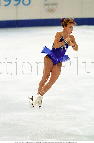 TARA LIPINSKI (USA) wins gold, Womens Free Skating, Winter Olympics, Nagano, Japan, 980220. Photo: Neil Tingle/Action Plus....1998.ice skating.winners.figure skating.olympic games.wintersports.winter sport.winter sports.wintersport.skate.skater.skaters.woman.iceskating ice-skating ice skating skater skaters