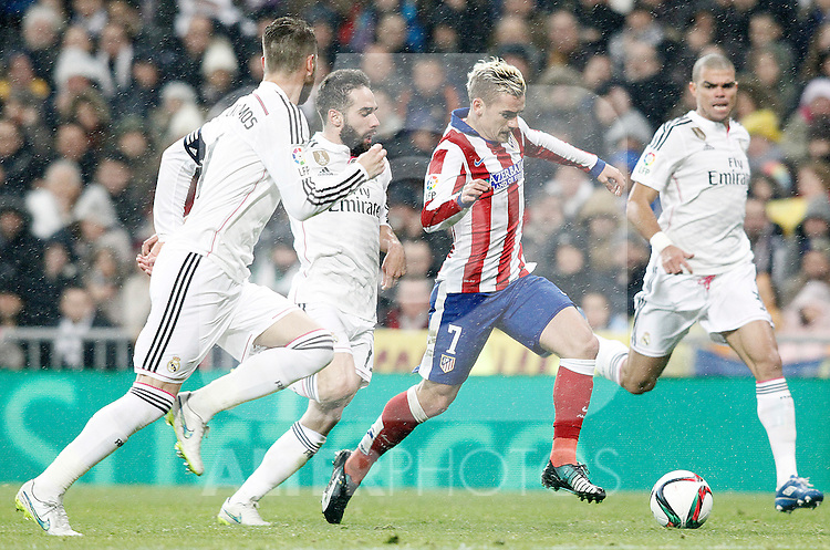 Real Madrid's Sergio Ramos (l), Daniel Carvajal (c-l) and Pepe (r) and Atletico de Madrid's Antoine Griezmann during Spanish King's Cup match.January 15,2015. (ALTERPHOTOS/Acero)