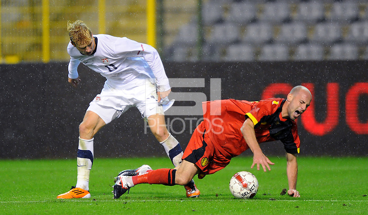 USA's Brek Shea (l) and Belgium's Laurent Ciman fight for the ball during the friendly match Belgium vs USA at King Baudoin stadium in Brussels, Belgium on September 06th, 2011.