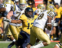 Jarred Price of California tackles UCLA tailback Malcolm Jones during the game at Memorial Stadium in Berkeley, California on October 9th, 2010.   California defeated UCLA, 35-7.