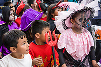 """Oaxaca, Mexico, North America.  Day of the Dead Celebrations.  Childrens' Parade, Procession, """"Comparsa"""", in Memory of the Dead.  Costumes."""