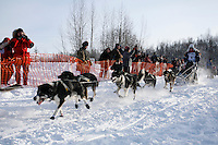 Sunday February 27, 2010   Anitra Winkler leaves the start line of the Junior Iditarod at Willow Lake, Alaska