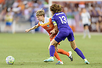 Rebecca Moros (4) of the Houston Dash battles Alex Morgan (13) of the Orlando Pride for the ball on Friday, May 20, 2016 at BBVA Compass Stadium in Houston Texas. The Orlando Pride defeated the Houston Dash 1-0.