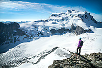 A woman on the Combin de Corbassière with Grand Combin in the background, Switzerland